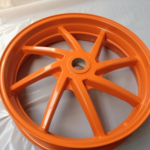 Motor bike wheel powdercoated#Repsol Honda colours